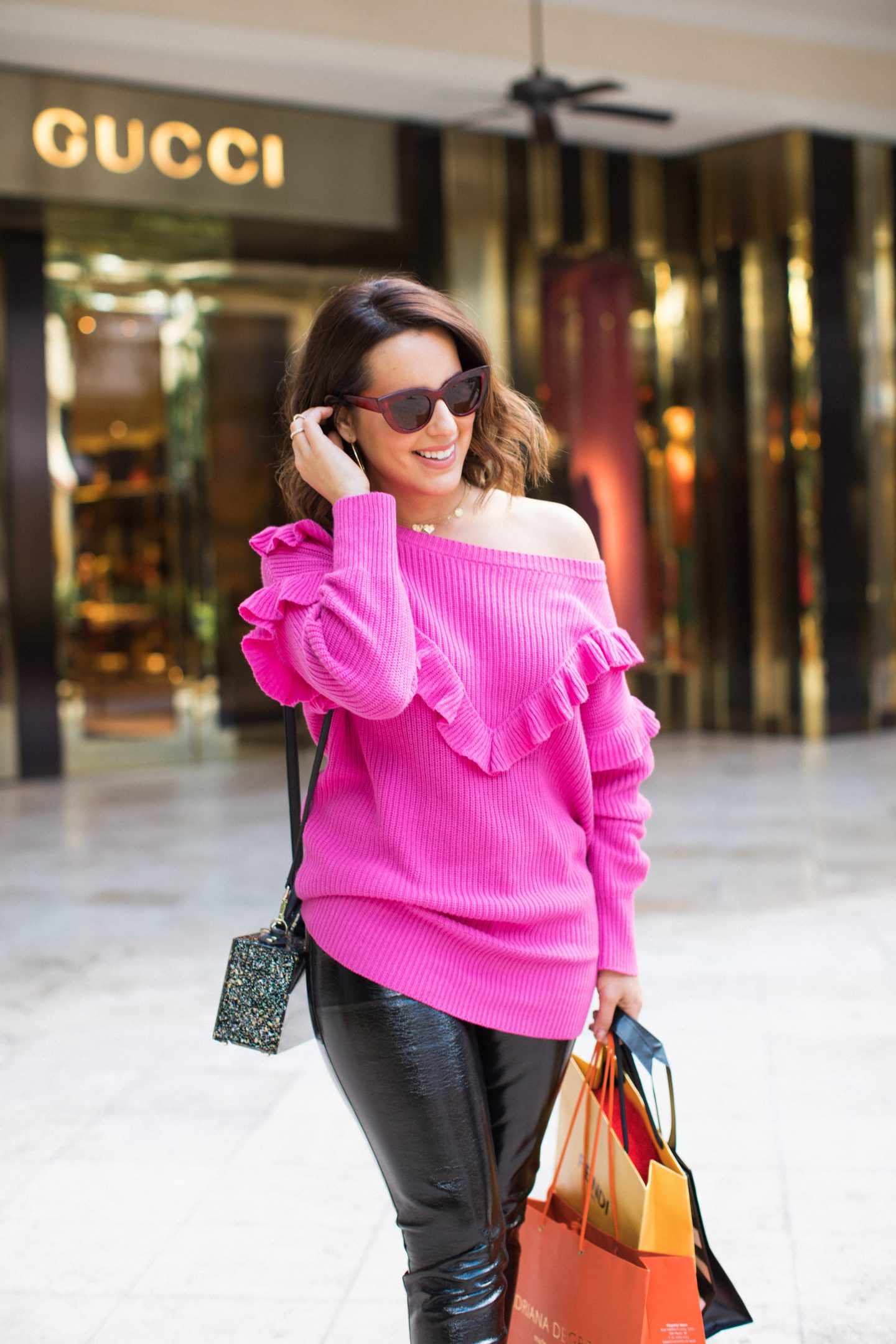 pink-sweater-vinyl-leather-pants-winter-outfit