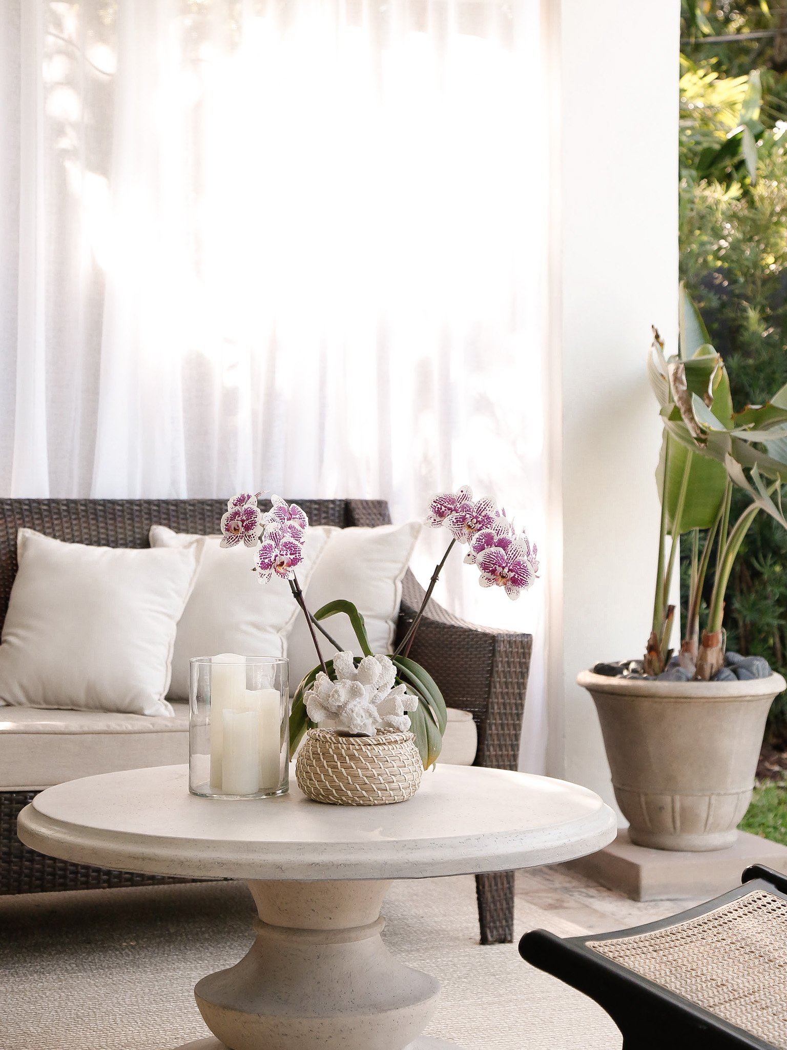 outdoor patio decor with white curtains
