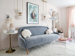 chic pastel pink home decor with blue velvet sofa